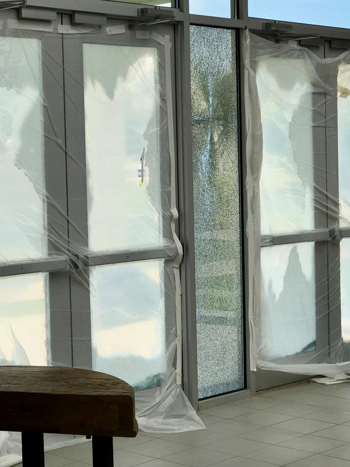 four glass doors shattered open by vandalism at church