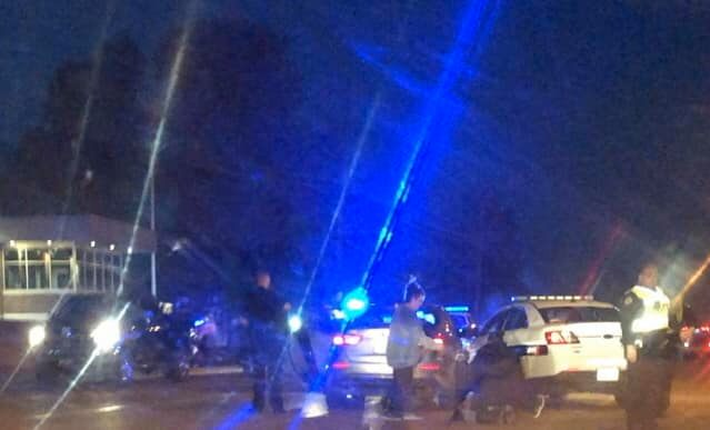 Police car hits another car on Caraway