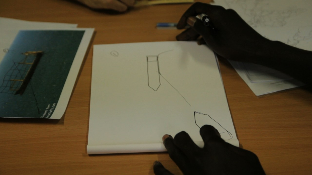 A survivor draws the collision-course between the migrants' vessel and the King Jacob cargo ship. The wreck occurred on April, 19 2015; more then 800 people perished in the collision.