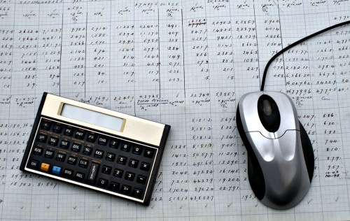 The old manual sheet, newer calculator and computer mouse
