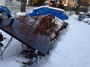 Snow melts and slides off solar panels after a snow storm.The glass on the solar panels warms up and the snow slides off.