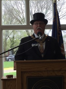 Grand Master Dennis E. Rix addressing the crowd at the Cornerstone Ceremony, Hastings College.