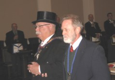 Grand Master Dennis E. Rix is escorted to the East.
