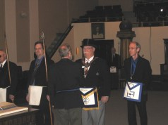 Grand Master Dennis E. Rix is greeted by Worshipful Master Daniel Deffenbaugh of Hastings Lodge No. 50.