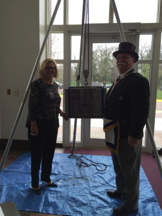 Kim Dinsdale and Grand Master Dennis E. Rix posing with the Cornerstone.