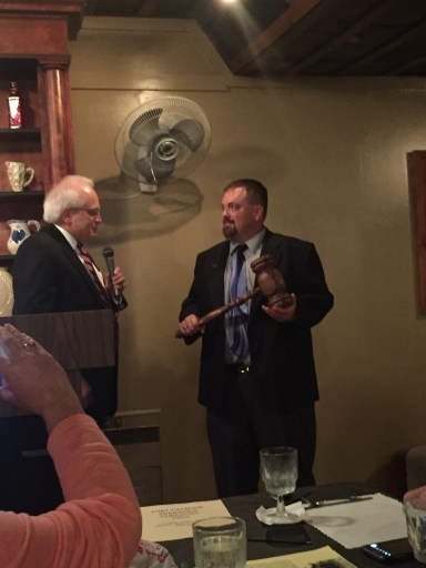Bob Schapp, Worshipful Master of Shiloh Lodge No. 327 presents the Sonny Eatmon Traveling Gavel to Worshipful Master Bradley Larsen of Solomon Lodge.