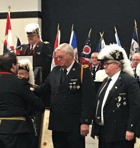 Grand Orator Ron Grass accepts proficiency congratulations as a representative of Jordan Commandery of Tekamah, Knights Templar.