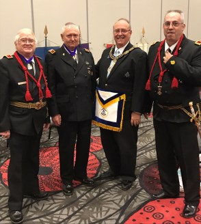 Grand Master Myers congratulates Nebraska's Knight Templar award winners at Grand York Rite.