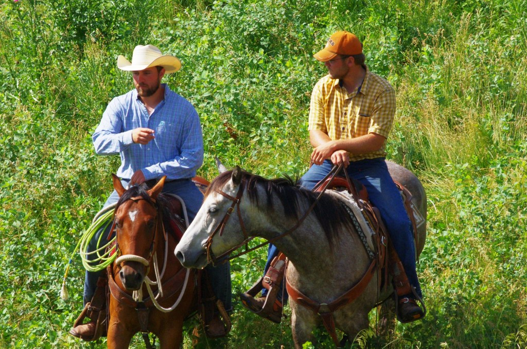 Ranchers discussing pastures.