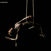 photo of an older woman performing on trapeze