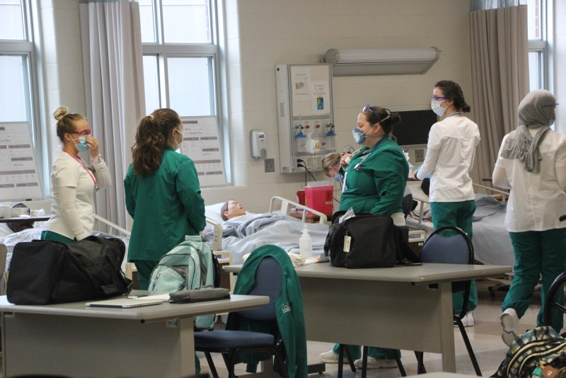 Nursing students practicing on fake patient