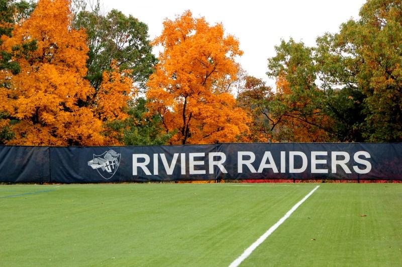 Rivier Raiders sign & trees