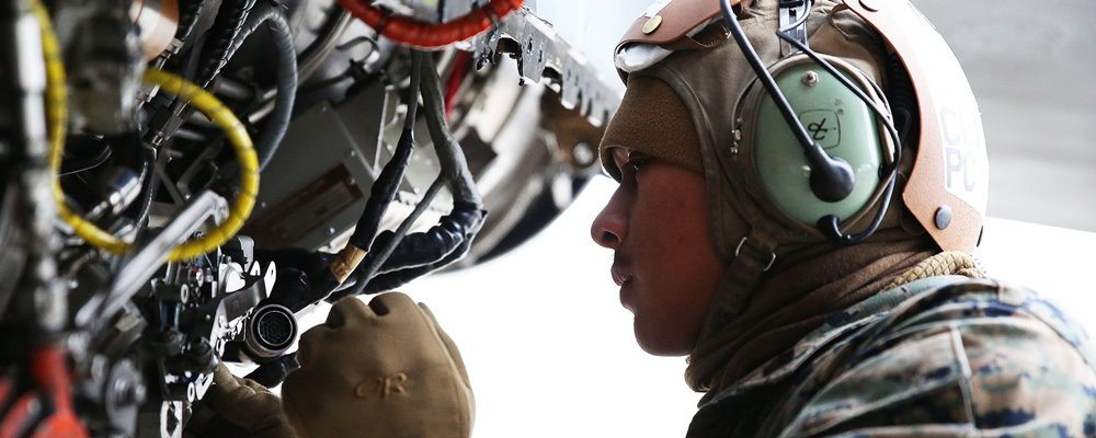Marine Corps Sgt. Avelinobong Quero works on an F/A-18D Hornet aircraft on Chitose Air Base in Hokkaido, Japan, Jan. 13, 2016. Quero is a fixed-wing aircraft mechanic assigned to Marine All Weather Fighter Attack Squadron 224. U.S. Marine Corps photo by Cpl. Jessica Quezada. The appearance of U.S. Department of Defense visual information does not imply or constitute DOD endorsement.
