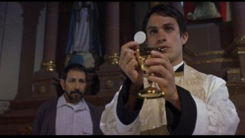 Gael García Bernal as Padre Amaro in The Crime of Padre Amaro