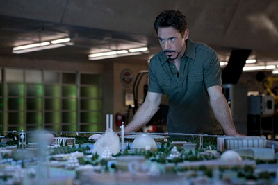 Robert Downey Jr as Tony Stark looking over the expo model from Iron Man 2
