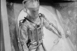 A Cyberman Emerges from Doctor Who: Tomb Of Cybermen
