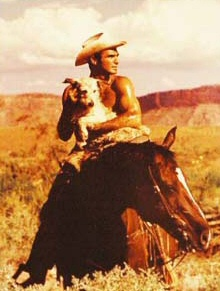 Burt Reynolds.  With a puppy.  On a horse.