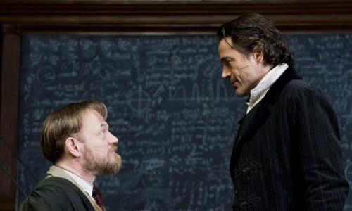Jared Harris as Moriarty and Robert Downey Jr. as Sherlock Holmes in Sherlock Holmes: A Game of Shadows
