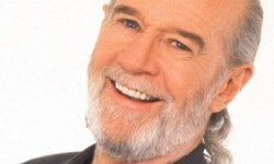 George Carlin grinning