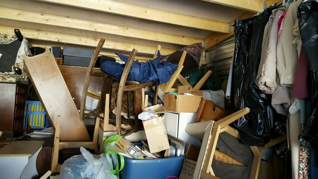 an abandoned storage unit bought at auction waiting to be emptied