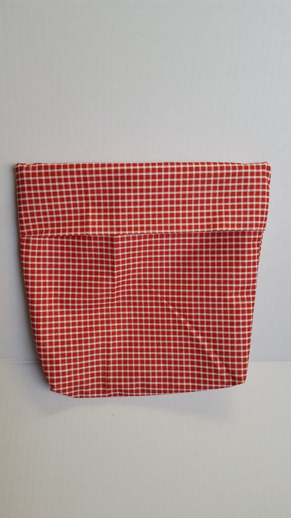 red plaid fabric on a microwave popcorn bag