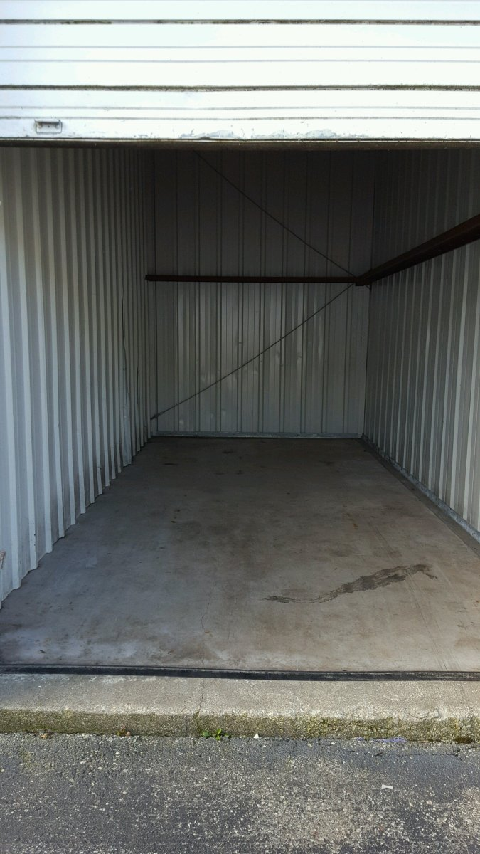 an empty storage unit that was emptied after a storage unit auction