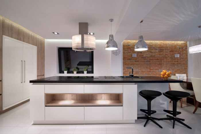kitchen lights large refrigerator stools clean counters kitchen lighting brick wall white floors
