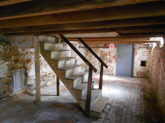 wooden stairway in a limestone basement with decay Getting To The Bottom Of Bumps In Your Basement