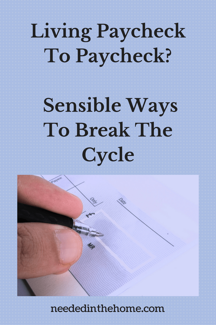 someone writing a check to pay a bill Living Paycheck To Paycheck? Sensible Ways To Break The Cycle