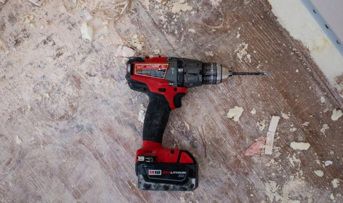 electric battery operated red drill on hardwood floor Home Maintenance For A Happy Spring