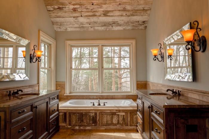 jacuzzi hot tub in bathroom two sinks counters mirrors wall lights antique barnboard barn board wood look luxury bathroom