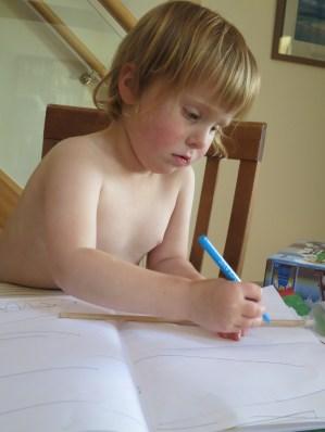 Drawing in her scrapbook