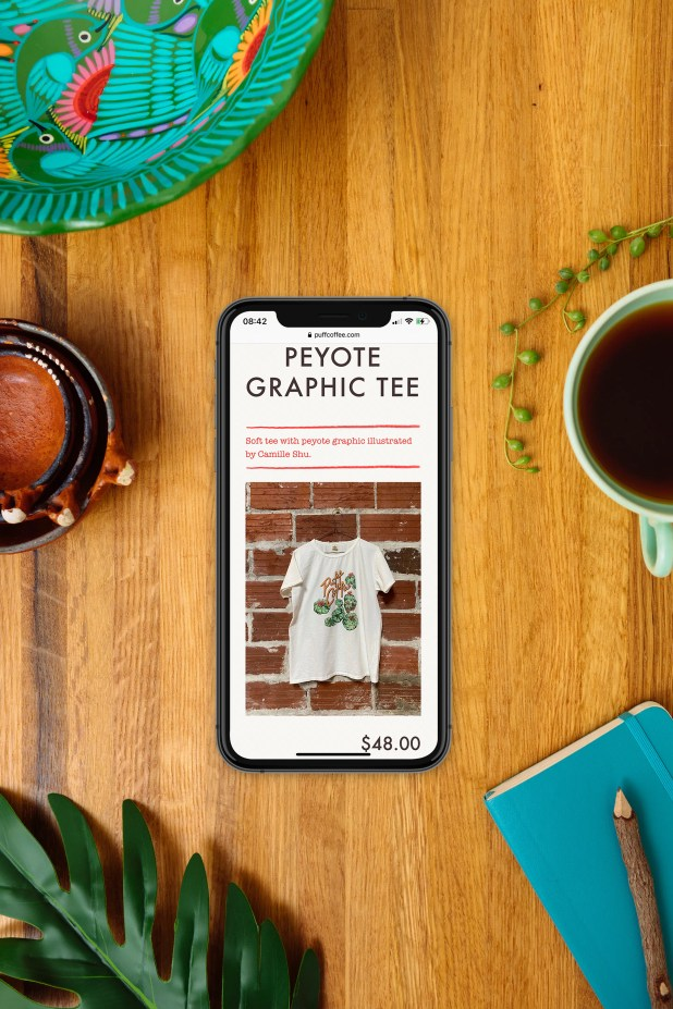 Puff Coffee graphic tee page on iPhone with plants and coffee