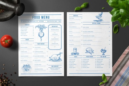 photo of a sample food menu surrounded by ingredients such as basil and tomato
