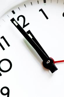 a clock showing the last minute of the 11th hour