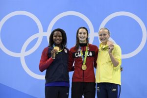 "Gold medallists USA's Simone Manuel (L) and Canada's Penny Oleksiak (C) pose with bronze medallist Sweden's Sarah Sjostrom on the podium of the Women's 100m Freestyle Final during the swimming event at the Rio 2016 Olympic Games at the Olympic Aquatics Stadium in Rio de Janeiro on August 11, 2016. / AFP PHOTO / CHRISTOPHE SIMON / ""The erroneous mention appearing in the metadata of this photo by CHRISTOPHE SIMON has been modified in AFP systems in the following manner: BRONZE instead of SILVER. Please immediately remove the erroneous mention[s] from all your online services and delete it from your servers. If you have been authorized by AFP to distribute it to third parties, please ensure that the same actions are carried out by them. Failure to promptly comply with these instructions will entail liability on your part for any continued or post notification usage. Therefore we thank you very much for all your attention and prompt action. We are sorry for the inconvenience this notification may cause and remain at your disposal for any further information you may require."""