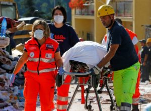 ATTENTION EDITORS - VISUALS COVERAGE OF SCENES OF DEATH OR INJURY A body is carried away following an earthquake in Amatrice, central Italy, August 24, 2016. REUTERS/Stefano Rellandini