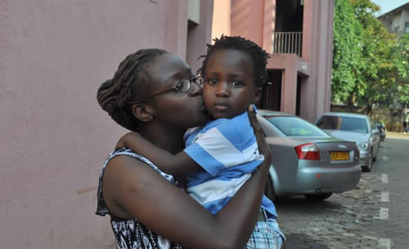 Free at last...Human rights campaigner Cynthia Manjoro reunites with her son David after her release from Chikurubi Prison on Wednesday 17 October 2012.