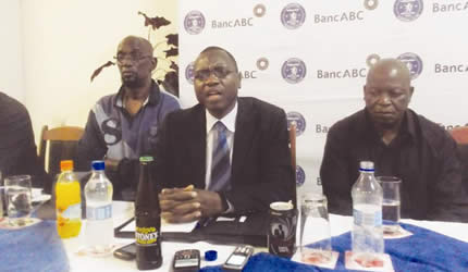 THE GLAMOUR BOYS . . . Dynamos board of directors secretary Chris Kasiyazi (centre) expresses a point while executive chairman Kenny Mubaiwa (left) and board member Benard Marriott-Lusengo follow proceedings at a Press conference in Harare yesterday