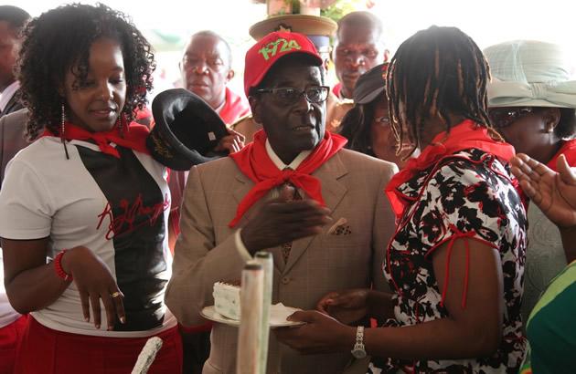 Bona, Robert and Grace Mugabe