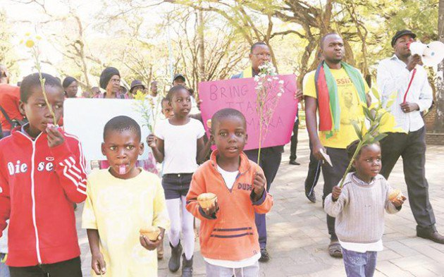 Itai Dzamara's children take part in the commemoration march for their missing father