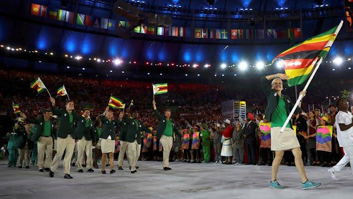 Kirsty Coventry leads the Zimbabwean team at the Rio Olympics opening ceremony