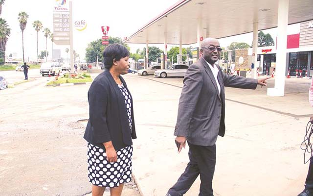 Acting Town Clerk Mrs Josephine Ncube (left) and Harare City Council director of works Engineer Phillip Pfukwa tour the Total Service Station along Simon Mazorodze Road in Mbare yesterday (Picture by Tawanda Mudimu)