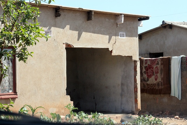 The Nkulumane house with a huge hole in one of the walls caused by Constable Munyaradzi Mupfawa