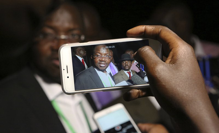 Thabani Mpofu lawyer for the opposition talks to the press outside the Constitutional Court in Harare, Wednesday, Aug, 22, 2018. Zimbabwe's Constitutional Court set to hear the main opposition challenge to the results of last months historic presidential election.The Chief Justice said that the ruling would be announced on Friday at 2pm.(AP Photo/Tsvangirayi Mukwazhi)