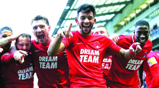 BOUNDLESS JOY . . . Zimbabwean striker Macauley Bonne (second from right) celebrates with his Lleyton Orient teammates after their team got promoted back into the English football's League Two after two seasons in the National League on Saturday.