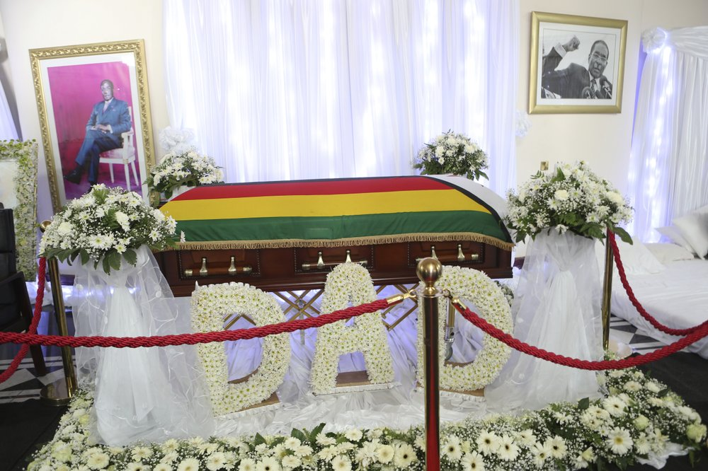 The coffin of the late former Zimbabwean leader Robert Mugabe at his residence in Harare, Thursday Sept. 12, 2019. Zimbabwe's founding leader Robert Mugabe made his final journey back to the country Wednesday, his body flown into the capital amid the contradictions of his long, controversial rule. (AP Photo/Tsvangirayi Mukwazhi)