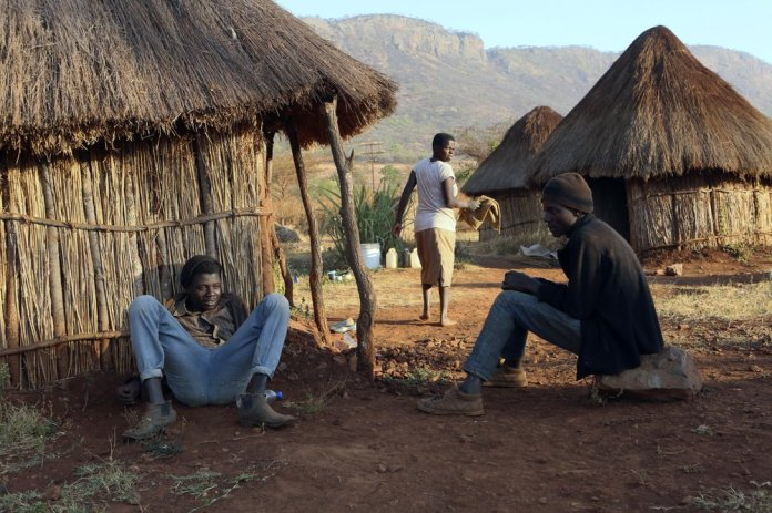 Farm workers at former Zimbabwean President Robert Mugabe's Dairy farm are seen at the farm compound in Mazoe, Zimbabwe, Monday, Sept, 9 2019. Mugabe, who enjoyed strong backing from Zimbabwe's people after taking over in 1980, but whose support waned following decades of repression, economic mismanagement and allegations of election-rigging, is expected to be buried on Sunday, state media reported. (AP Photo/Tsvangirayi Mukwazhi)