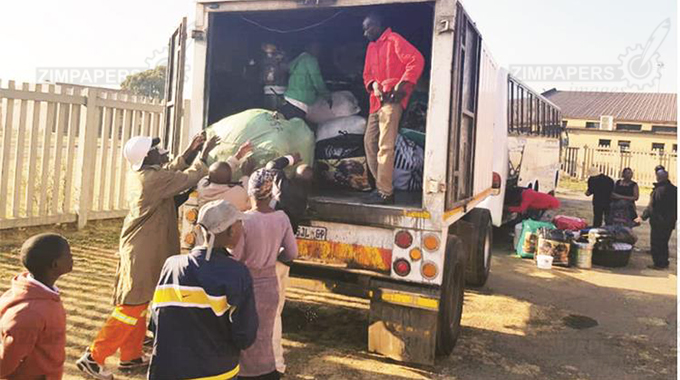 Zimbabweans who have volunteered to come home load their wares at Tsolo Hall in Katlegong under Ekhurhuleni City, South Africa. — Picture: Thupeyo Mleya
