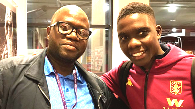"""ZIMBABWEAN AFFAIR . . . Aston Villa midfielder Marvelous Nakamba (left) poses for a photograph with fellow Zimbabwean, Stanley Kwenda, a journalist and producer of the BBC """"Where Are They Now'' series, at the Emirates in London on Sunday night"""